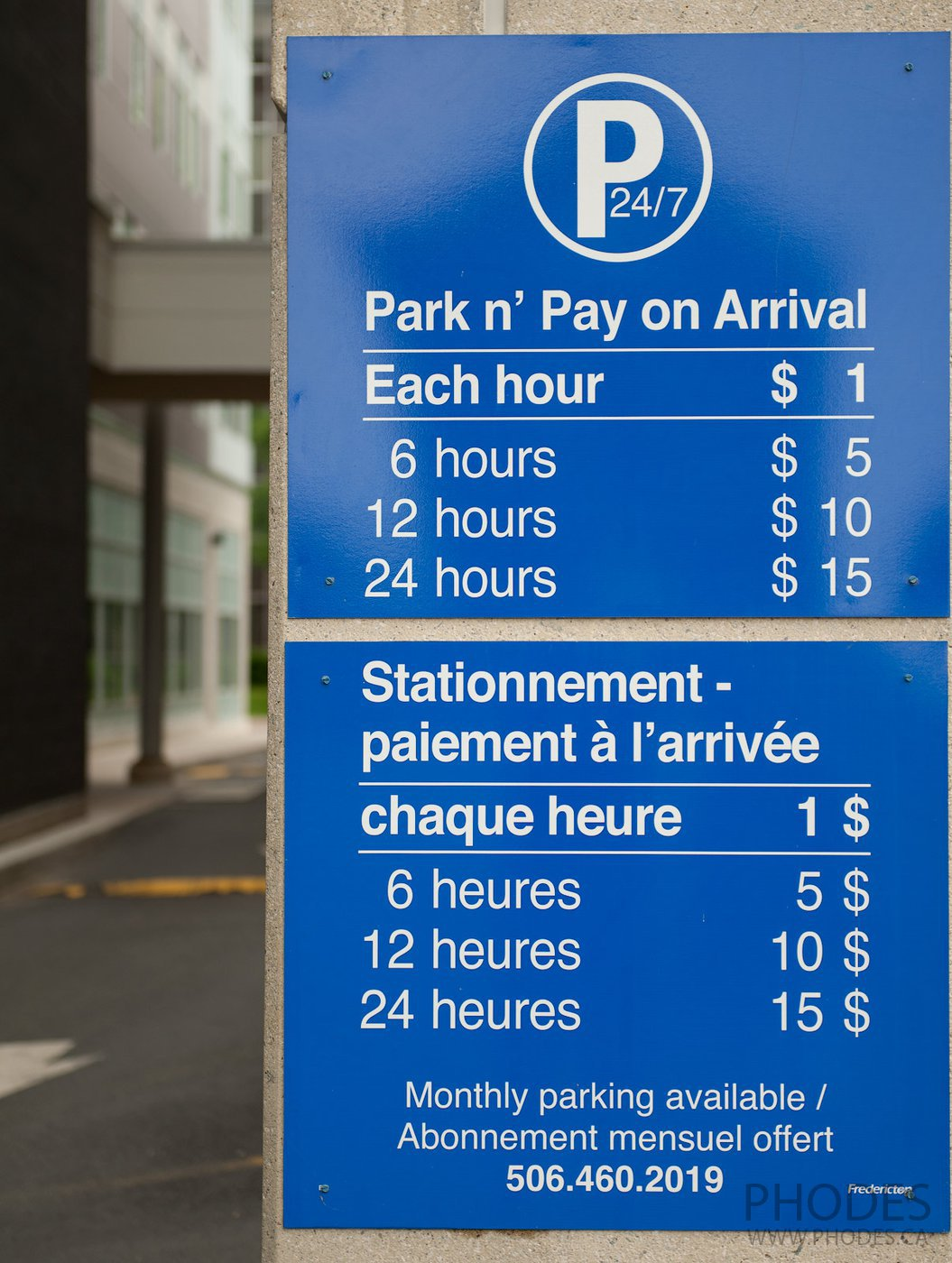 Sign with the prices for parking in Fredericton