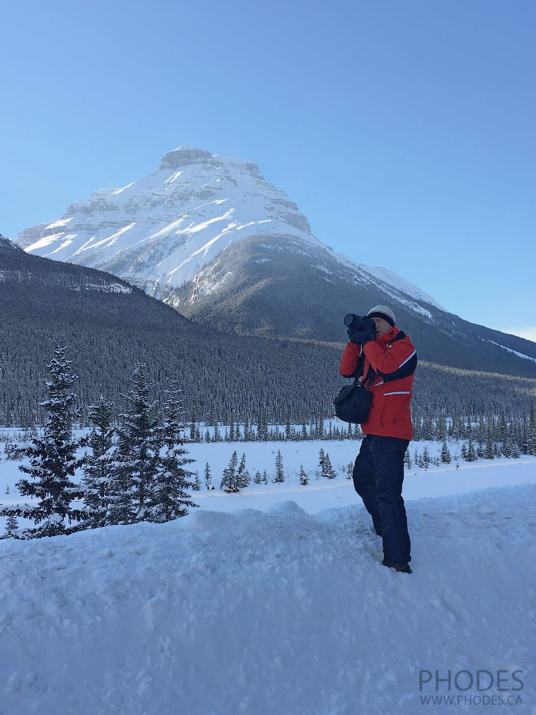 Photographer taking picture in winter Banff